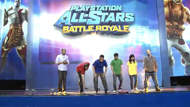 Sony reps showing the cross-compatibility for <em>AllStars</em> between the Vita and PS3.