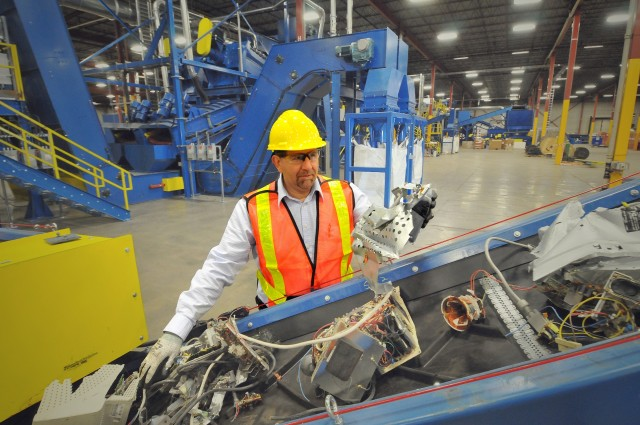 A worker sorts through computer parts at one of Sims' recycling facilities.