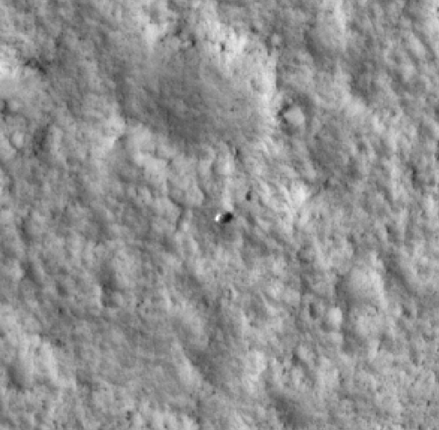 The Viking 1 lander (the small rounded object at center), as seen from orbit by the HiRise camera on the Mars Reconnaissance Orbiter (MRO).