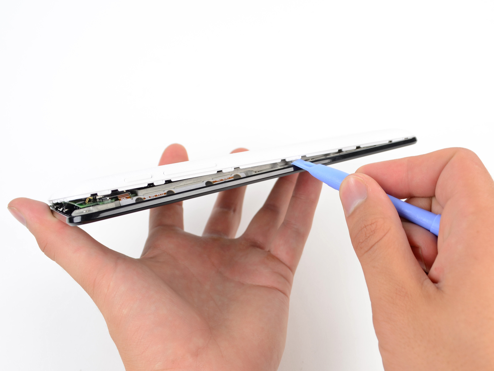 iFixit opened up the Nexus using one of its trusty plastic opening tools.