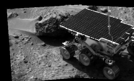 The Sojourner rover meets a rock on Mars. The image was taken by the Carl Sagan Memorial Station, the immobile part of the Mars Pathfinder mission.