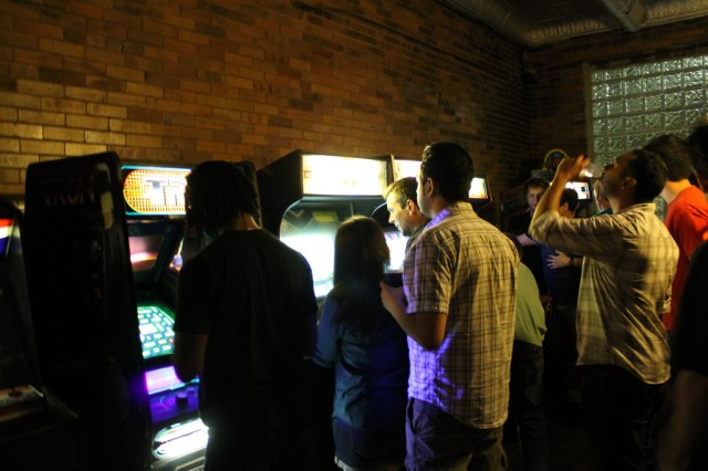People getting their game and drink on during opening night at Emporium Arcade and Bar.