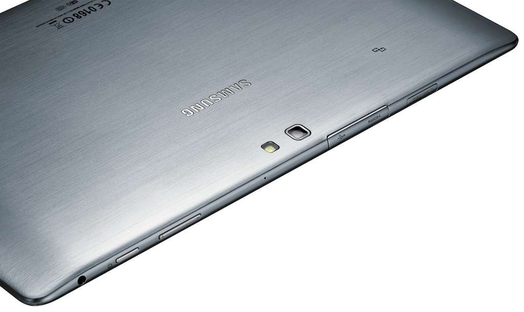 The top of the ATIV tab shows its camera and LED flash, NFC symbol, power and volume buttons, and complement of ports: USB, mini HDMI, and microSD card