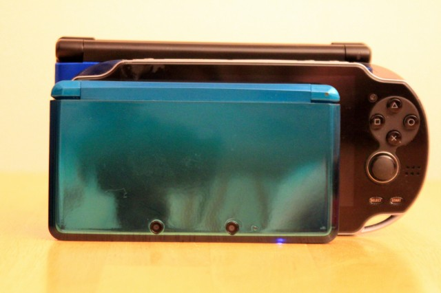 Height and width comparison of portable systems. Front to back: 3DS, Vita, 3DS XL