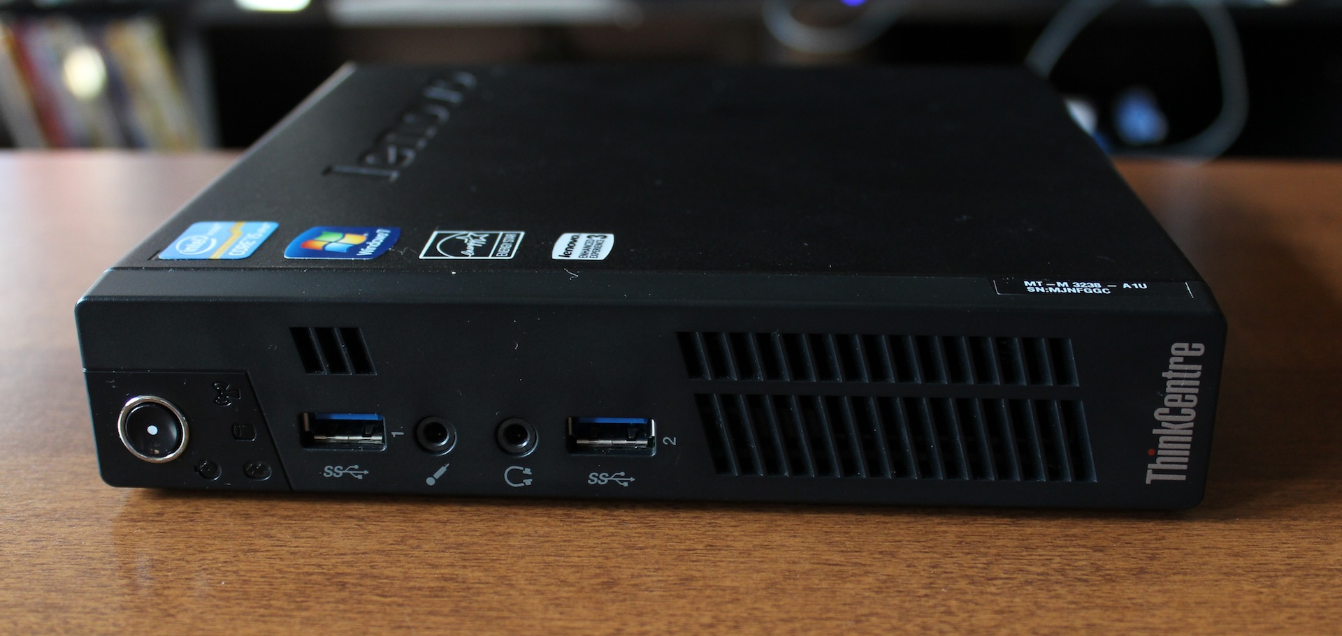 On the front of the M92p: a power button, activity lights, two USB 3.0 ports, and audio jacks.