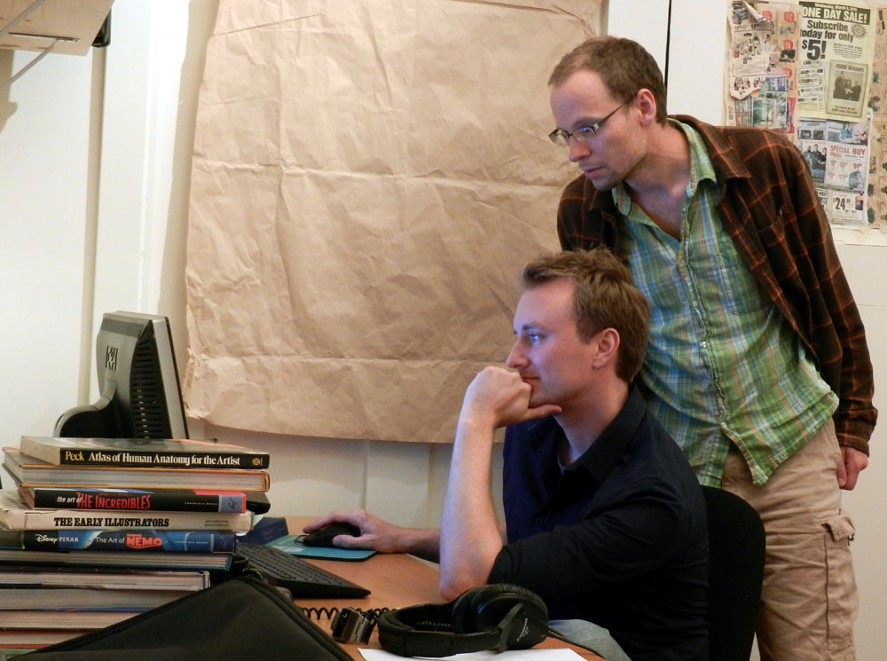 Dev Chris Hecker (standing) hired his former colleague John Cimino (sitting), after working together on <em>Spore</em>.