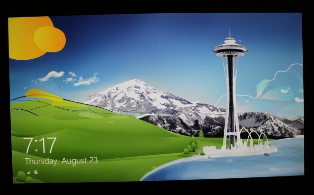 The UX31A's screen viewed straight-on, using one of the colorful login screen wallpapers from Windows 8.