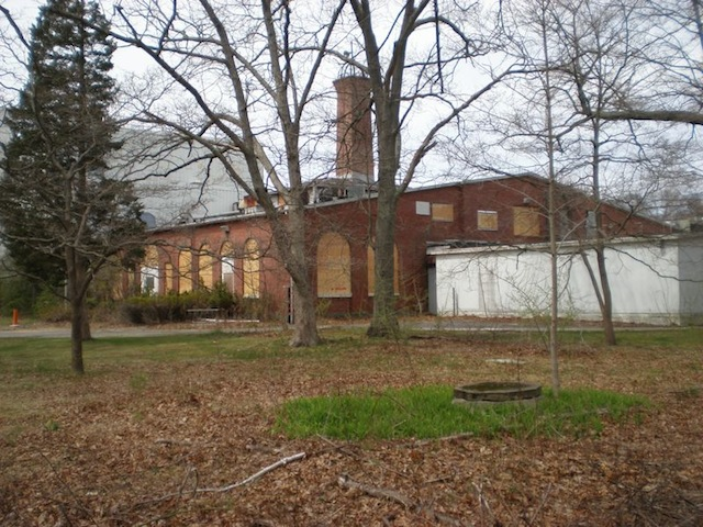 Wardenclyffe as it stood on Long Island in 2009, windows boarded up.