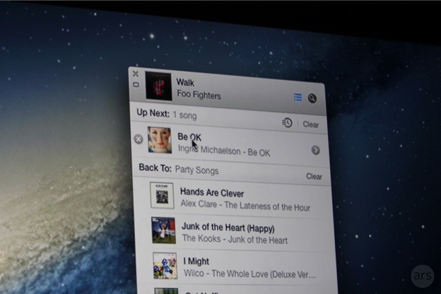 An expanded iTunes mini player.