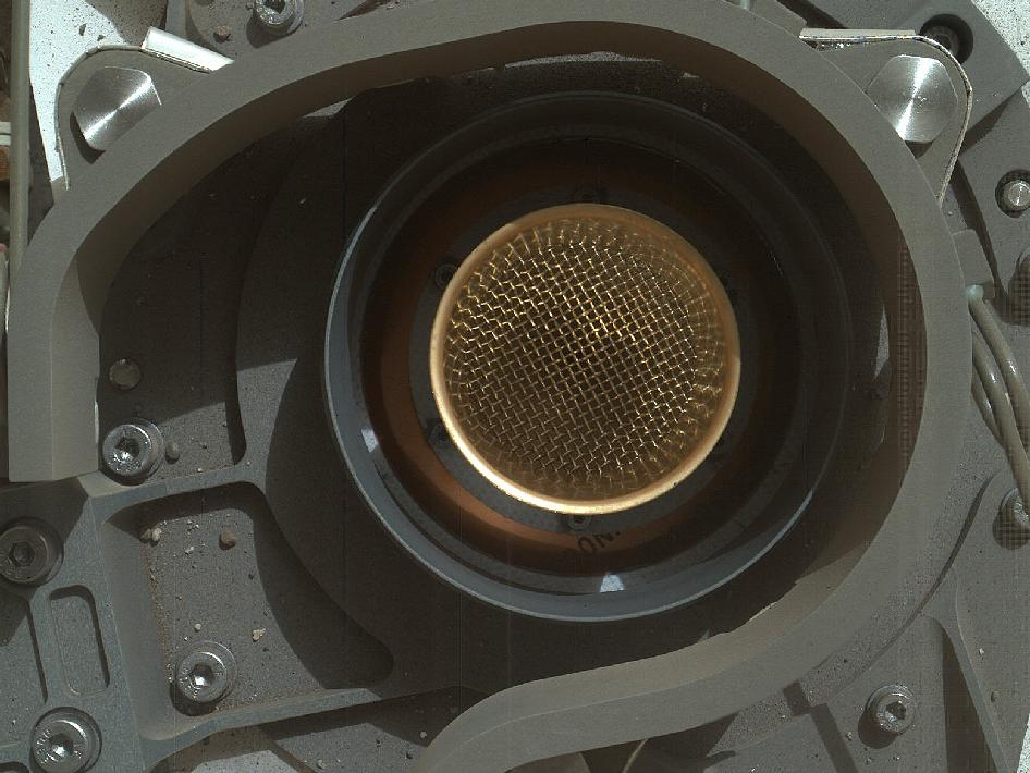 And after the lid on the chem lab's sample intake cover was popped open. This is another MAHLI image, taken from about 20cm away, and the dust particles provide a good indication of the camera's capabilities.