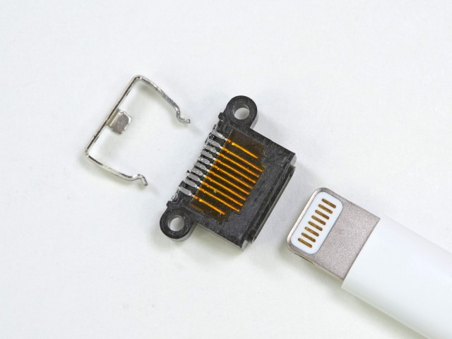 The iPhone 5's Lightning connector disassembled. Note two extra pins, possibly for ground return.