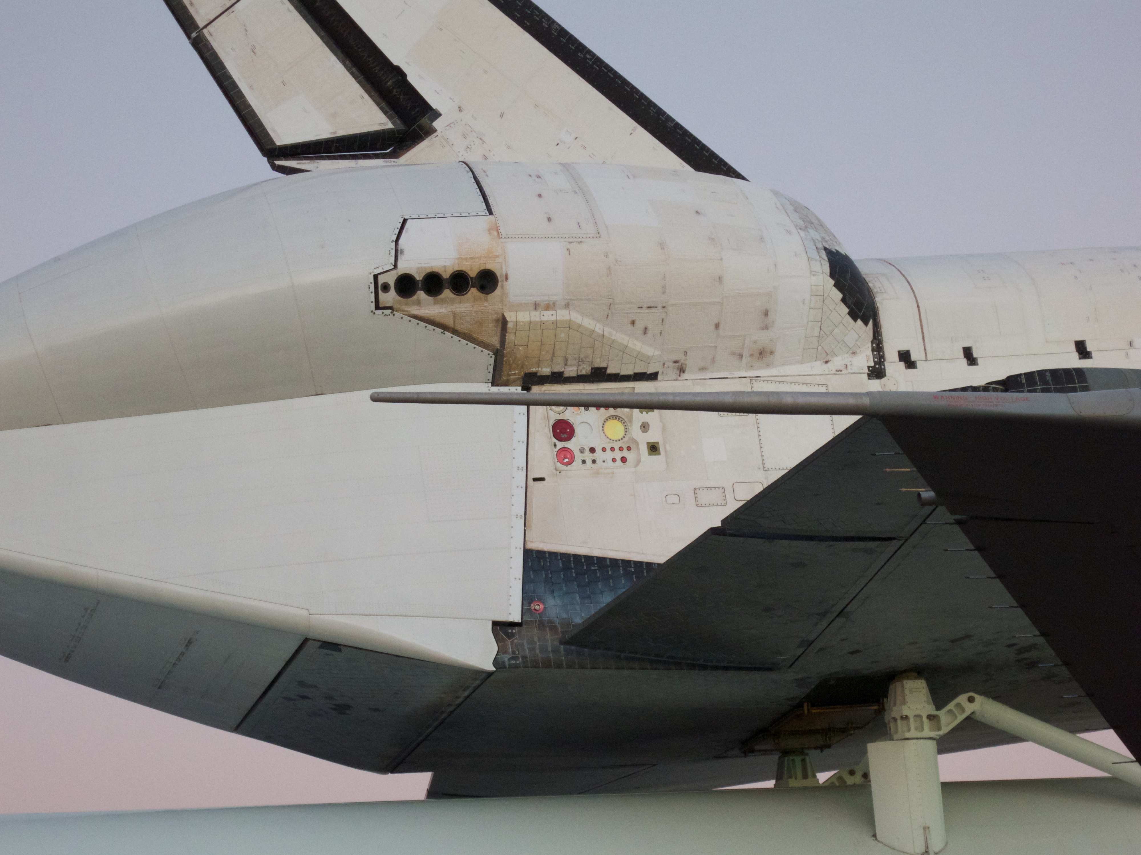 Detail of Endeavour's umbilical ports. These are connected to the Tail Servicing Mast prior to launch and are used to load propellent and provide ground power to the vehicle.