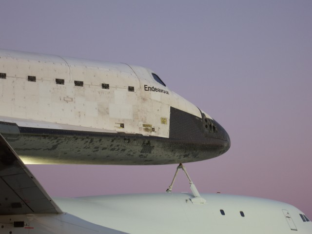 Closer view of Endeavour's forward section, showing the flight deck and cargo bay door details.
