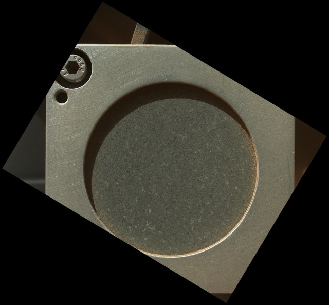 But first, it was tested using this slice of New Mexico basalt, carried on the rover.