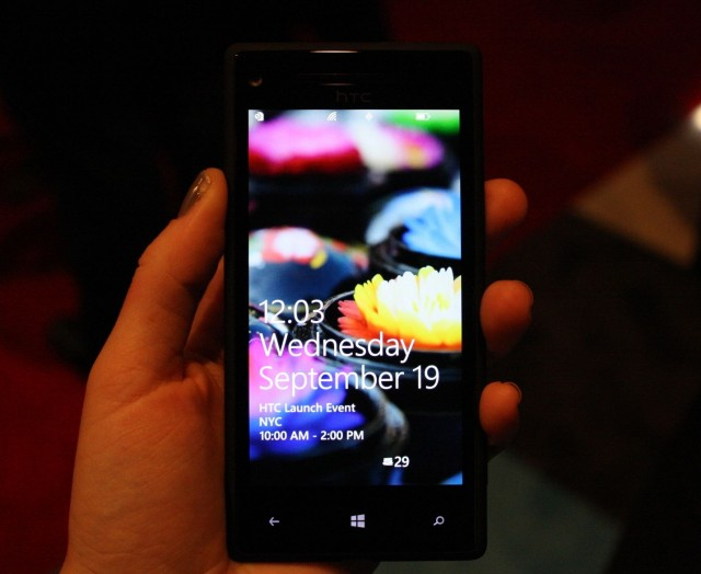 An HTC 8X in hand.