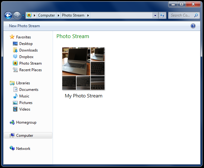 Photo Streams show up as such in Windows Explorer now. Previously you'd have to navigate to a designated folder to see your pictures.