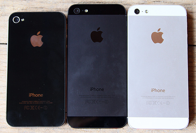 Left to right: Black iPhone 4S, black iPhone 5, white iPhone 5.