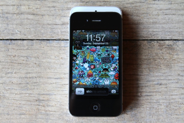 An iPhone 4S stacked on top of an iPhone 5. Here, you can see the difference in height.