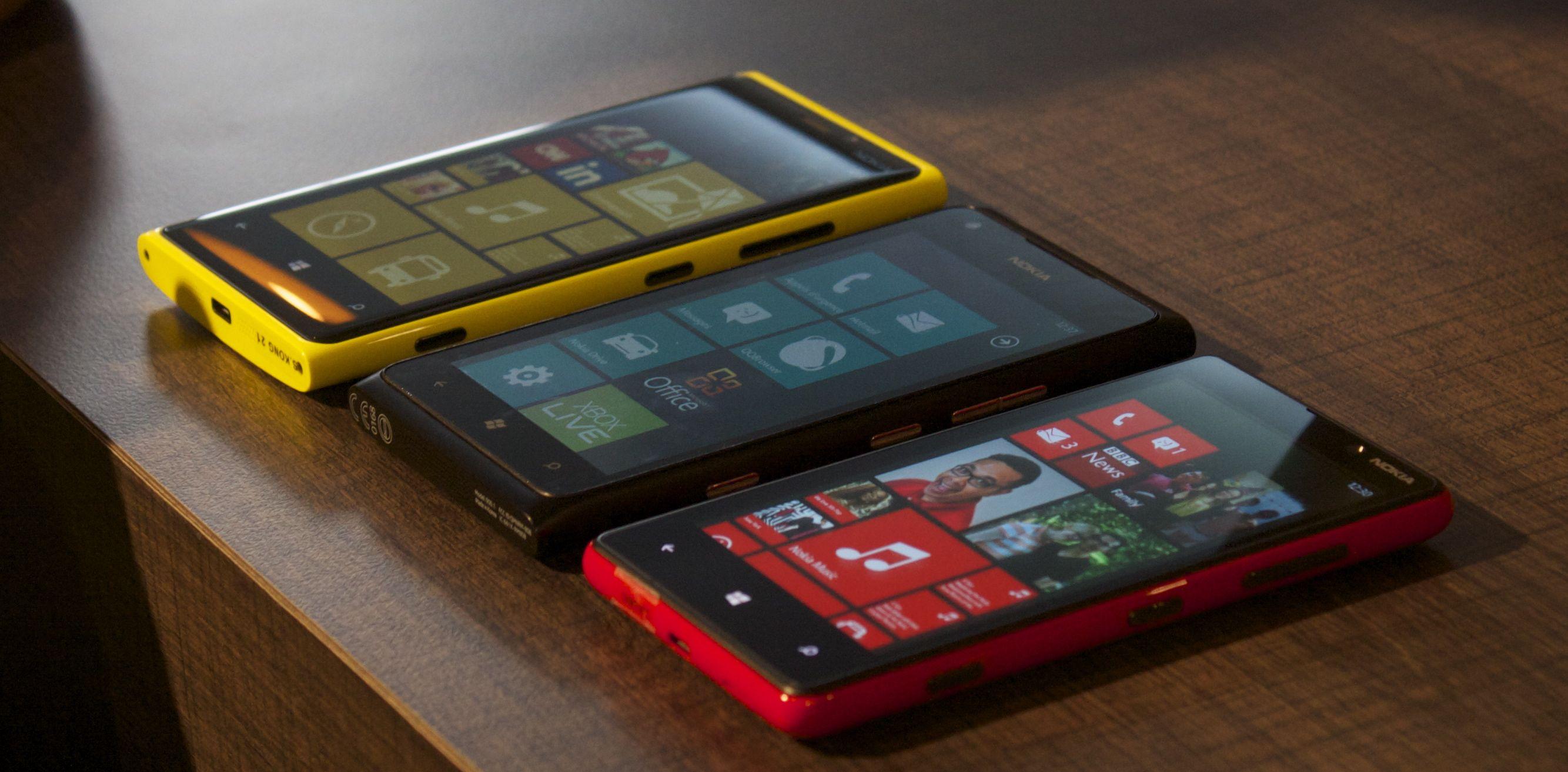 A yellow Lumia 920, black Lumia 900, and red Lumia 820