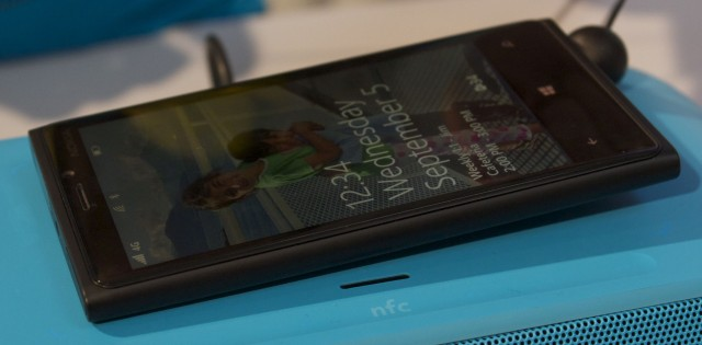 Pairing and charging with an NFC speaker