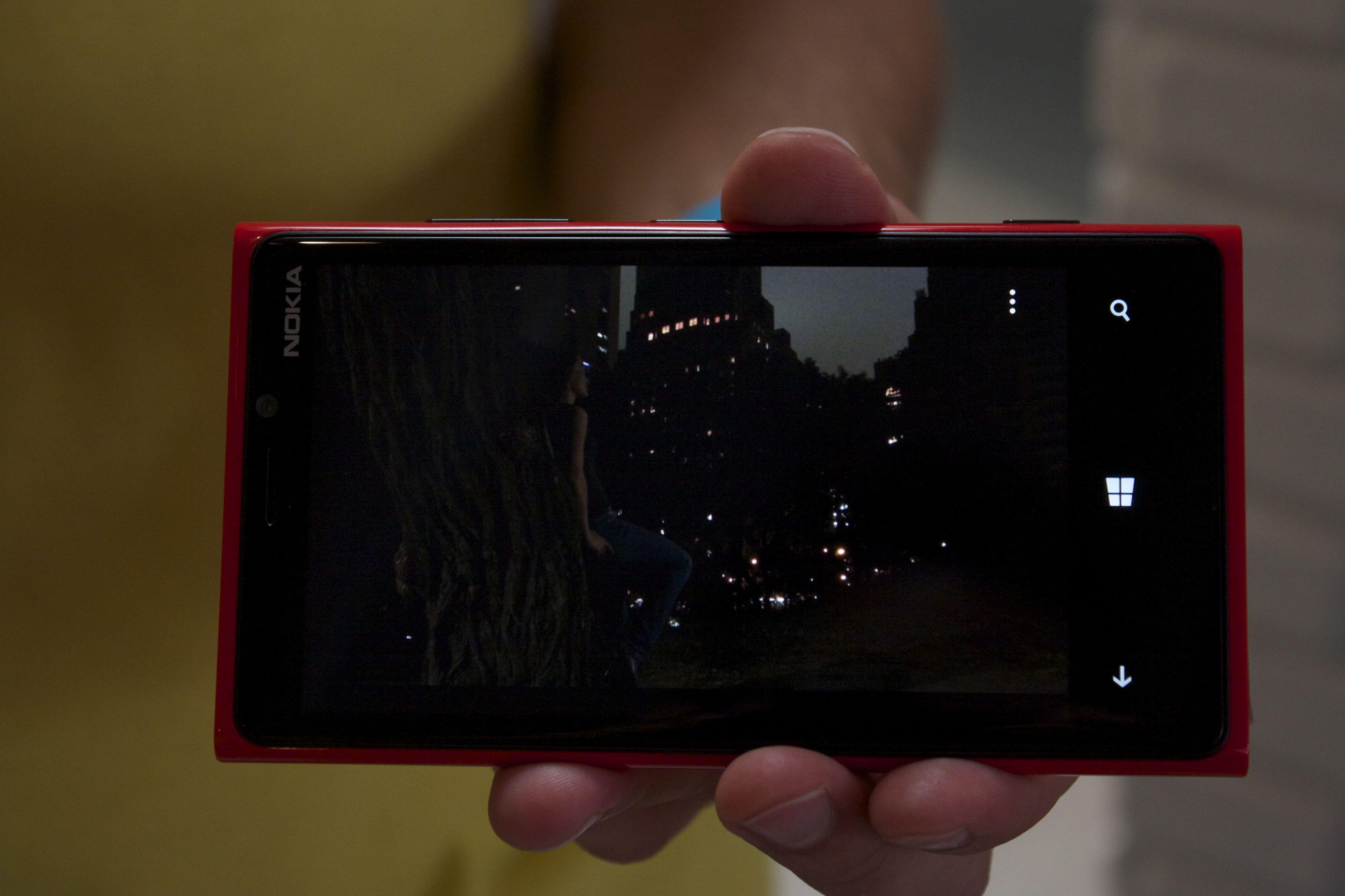 "A ""competing smartphone"" in a low light scenario, no flash"