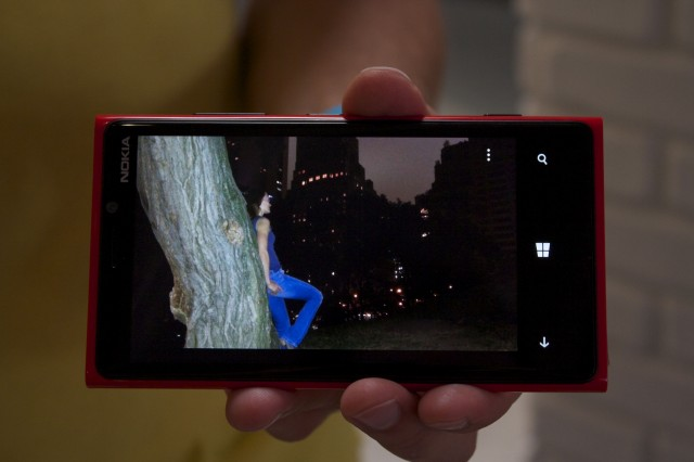 """A """"competing smartphone"""" in a low light scenario, with flash"""