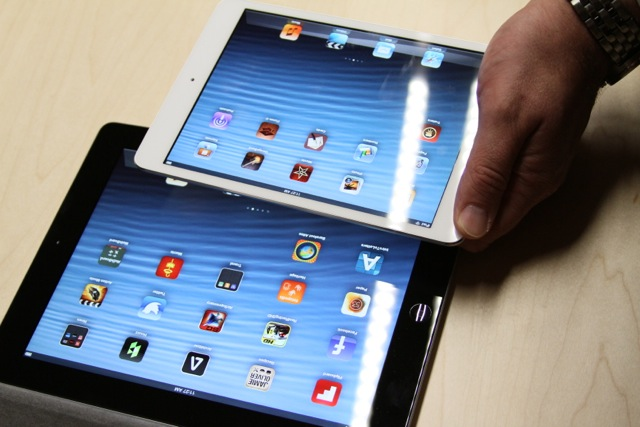 An iPad mini being compared against a fourth-generation (full-sized) iPad.