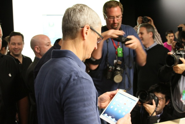 Tim Cook demoing the white iPad mini.