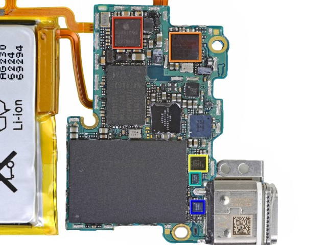 The massive chip is a 16GB Toshiba NAND flash, and the rectangular chip is an NXP ARM-based system-on-a-chip.