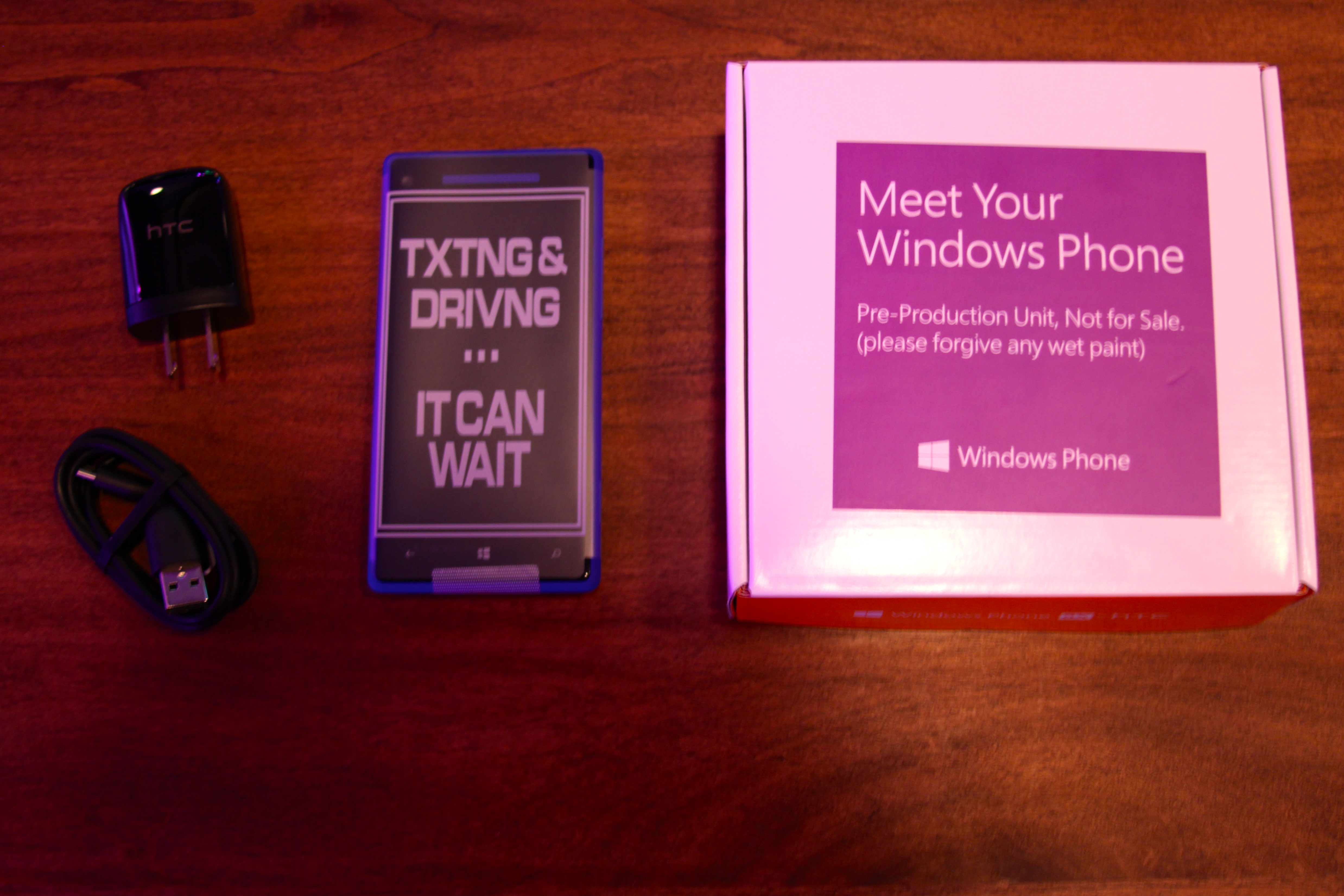 The HTC Windows Phone 8X alongside its box. Don't text and drive.