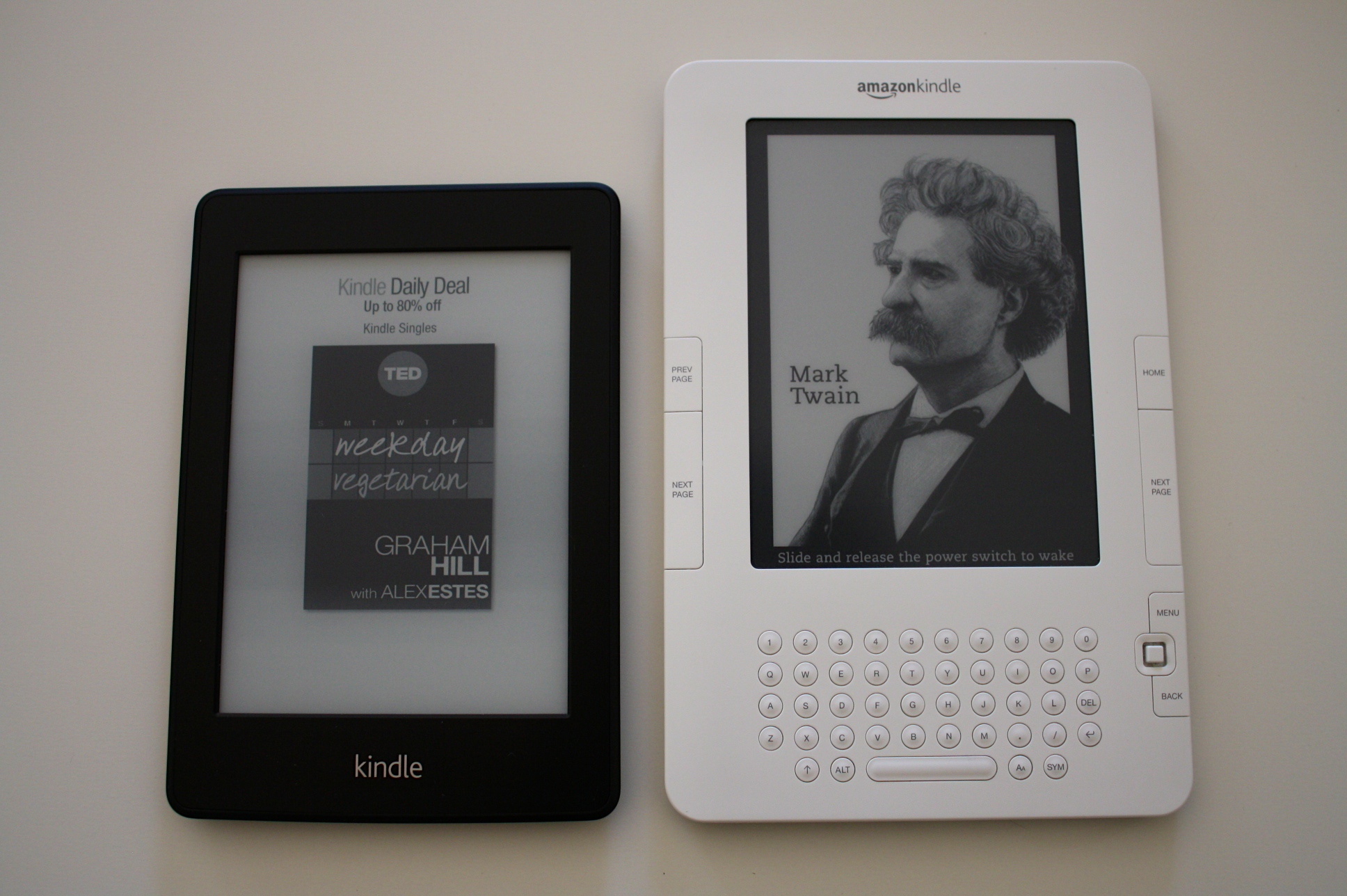The Kindle Paperwhite and a second-generation Kindle, side by side.
