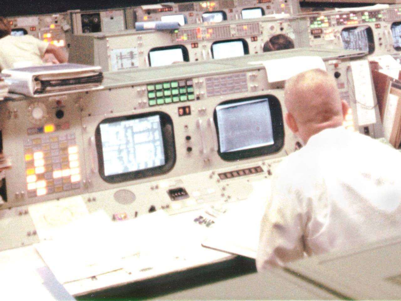 A close-up of Flight Director Gene Kranz's console during Apollo 13, showing his PABX module at left. Yellow lights indicate loops which he is passively monitoring, and white indicate loops on which he can speak. Kranz has a lot of active channels in this picture.