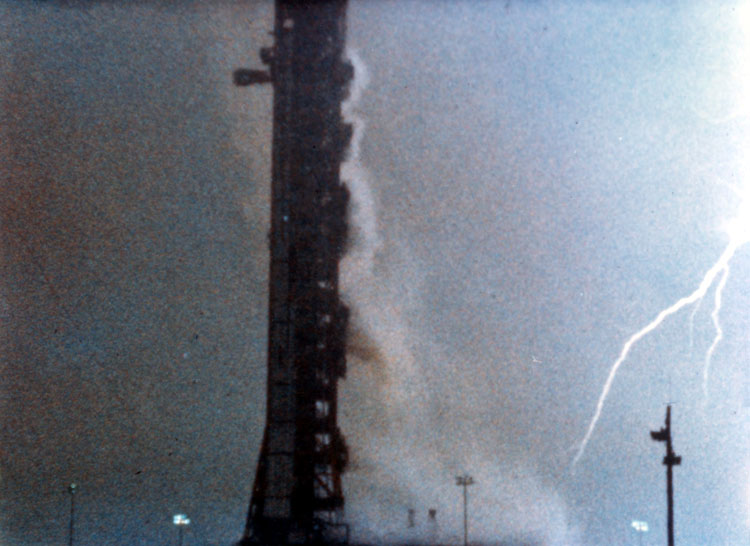 Lightning strikes around the launch pad shortly after the liftoff of Apollo 12.