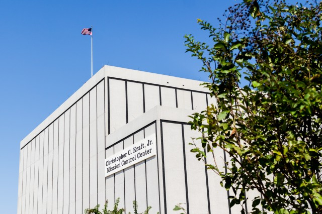 "The exterior of Building 30, which houses the rooms collectively known as ""mission control."" The flag on the roof flies whenever there is at least one American in space."