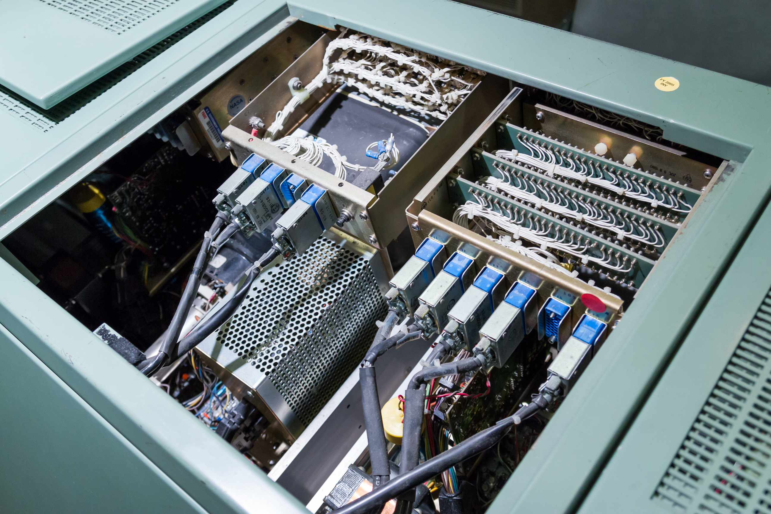 "Looking down into one of the MOCR consoles, filled with shuttle-era hardware. Note ""July 1980"" stamp at upper right."
