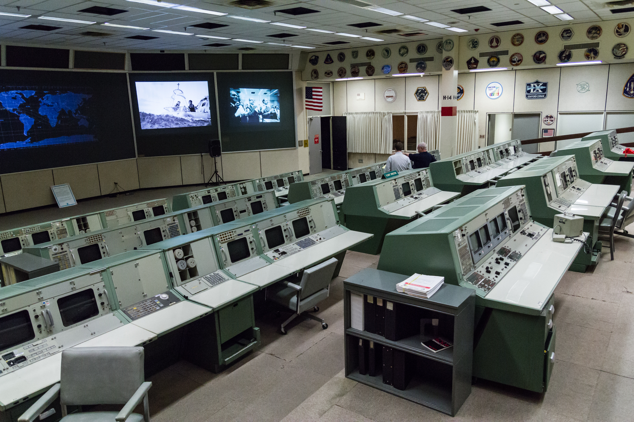 "MOCR 2 overview from the top left. Just visible at right is the red ""Bat Phone"" on the Department of Defense controller console."