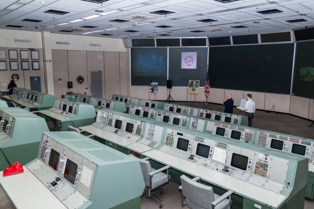 MOCR 2, from the top row next to the DoD console, looking across at the left front rear projection screens.