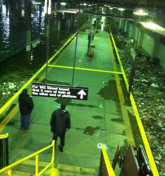 A subway station, with tracks submerged.