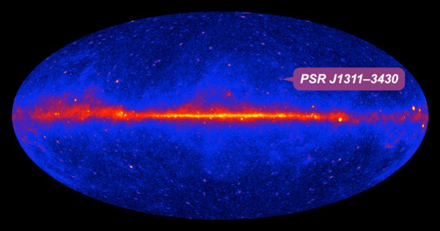The location of the gamma ray millisecond pulsar in the Fermi all-sky map. The bright band across the center of the image is the Milky Way; brighter colors indicate higher gamma ray intensity.