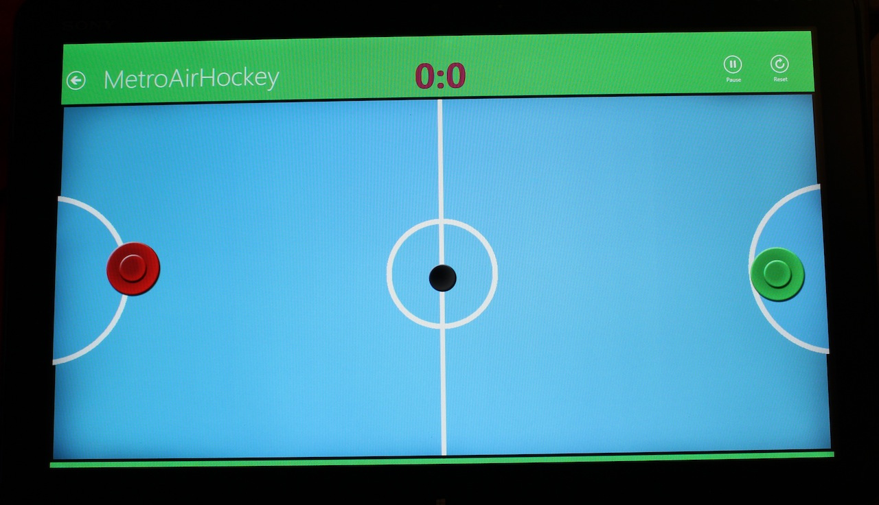 A two-player air hockey game being demoed on the Tap 20's screen.
