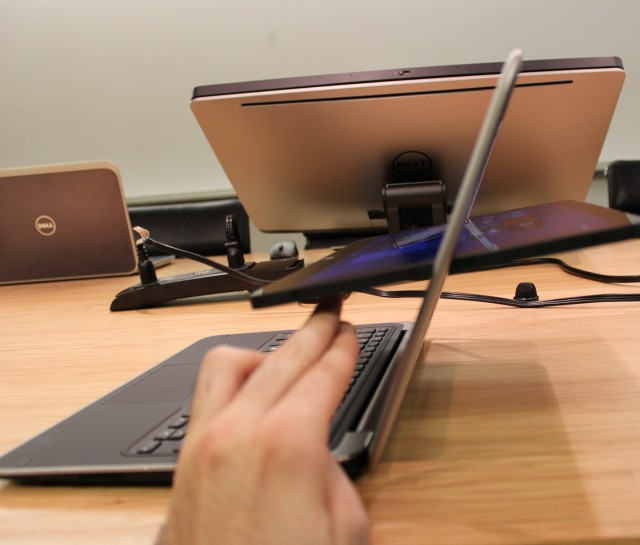 Flipping the XPS 12's screen into tablet mode.