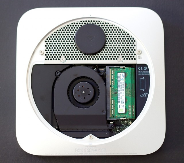 The mini, with the bottom cover removed. Visible is the Airport Wi-Fi antenna at top, the RAM at right, and the system's single fan.