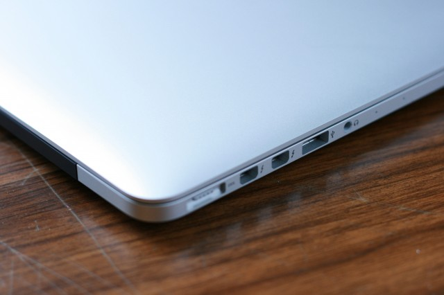 """On the left side, the 13"""" Retina MacBook Pro has a MagSafe 2 connector, two Thunderbolt ports, a USB 3.0 port, and an audio out jack."""