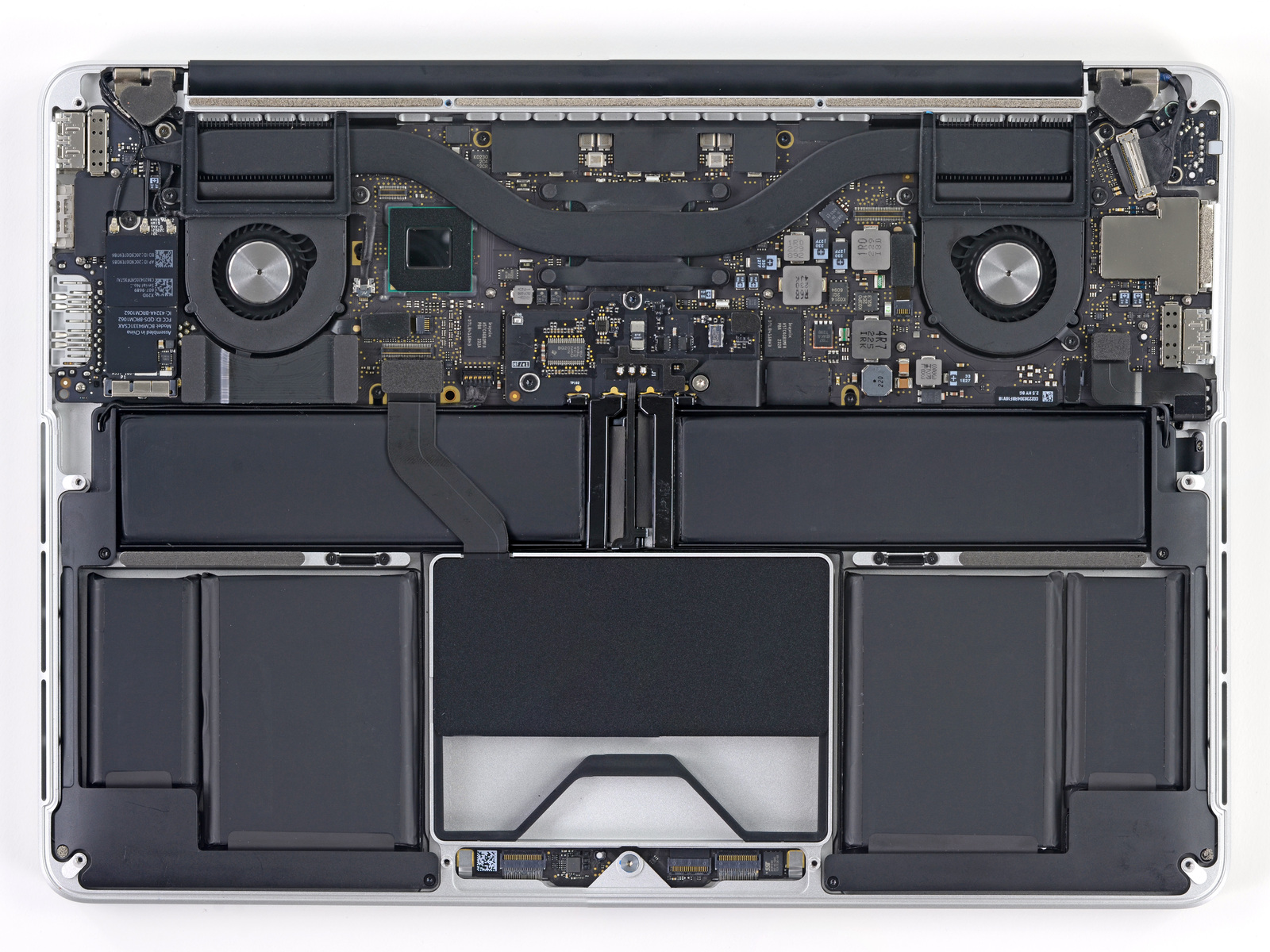 "The inside of the 13"" Retina MacBook Pro. Note the two fans connected to the processor by heat pipes, and the SSD module tucked in underneath the trackpad."