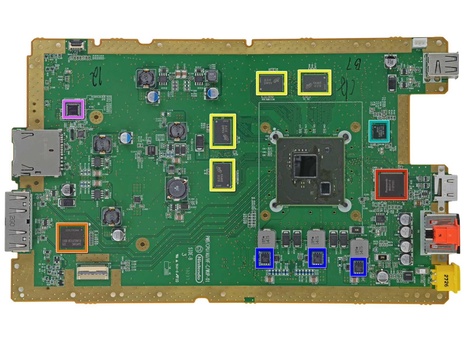 The Wii U motherboard, showing SDRAM in yellow and unshielded CPU and GPU to the right.