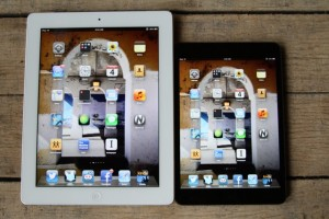 A 10-inch iPad 3, left, next to an iPad mini
