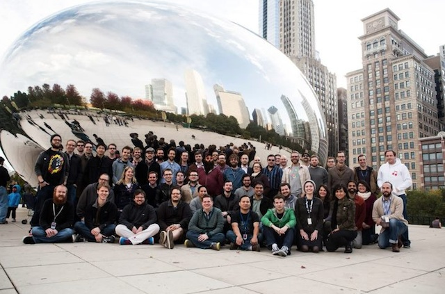 "The full team in front of Chicago's ""Bean."""