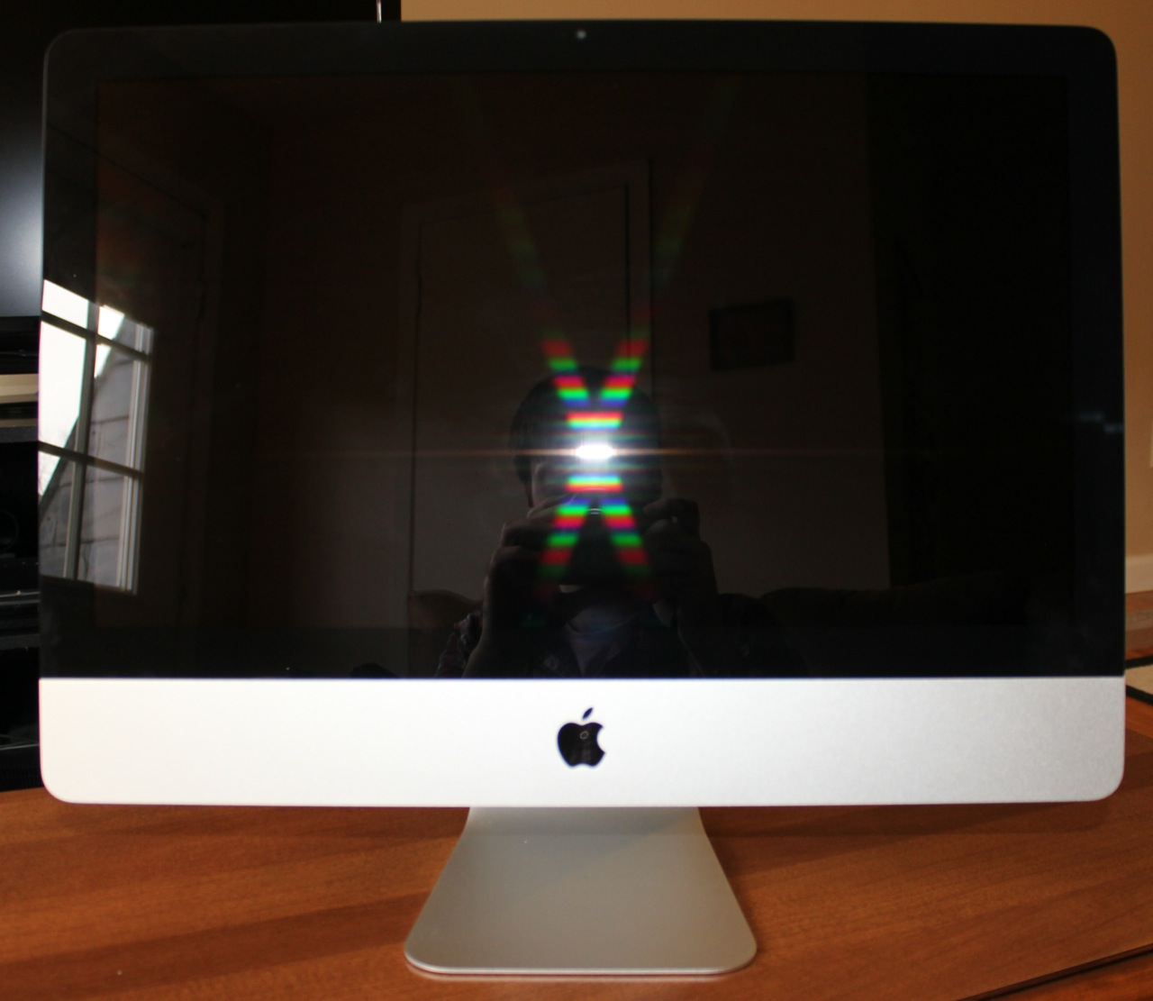I popped open my camera's flash and took a couple of pictures to compare screen glare—the 2011 iMac, shown here, is quite reflective.