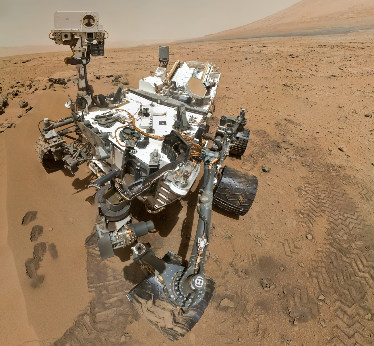 NASA's <em>Curiosity</em> rover on Mars—doing science, still alive.