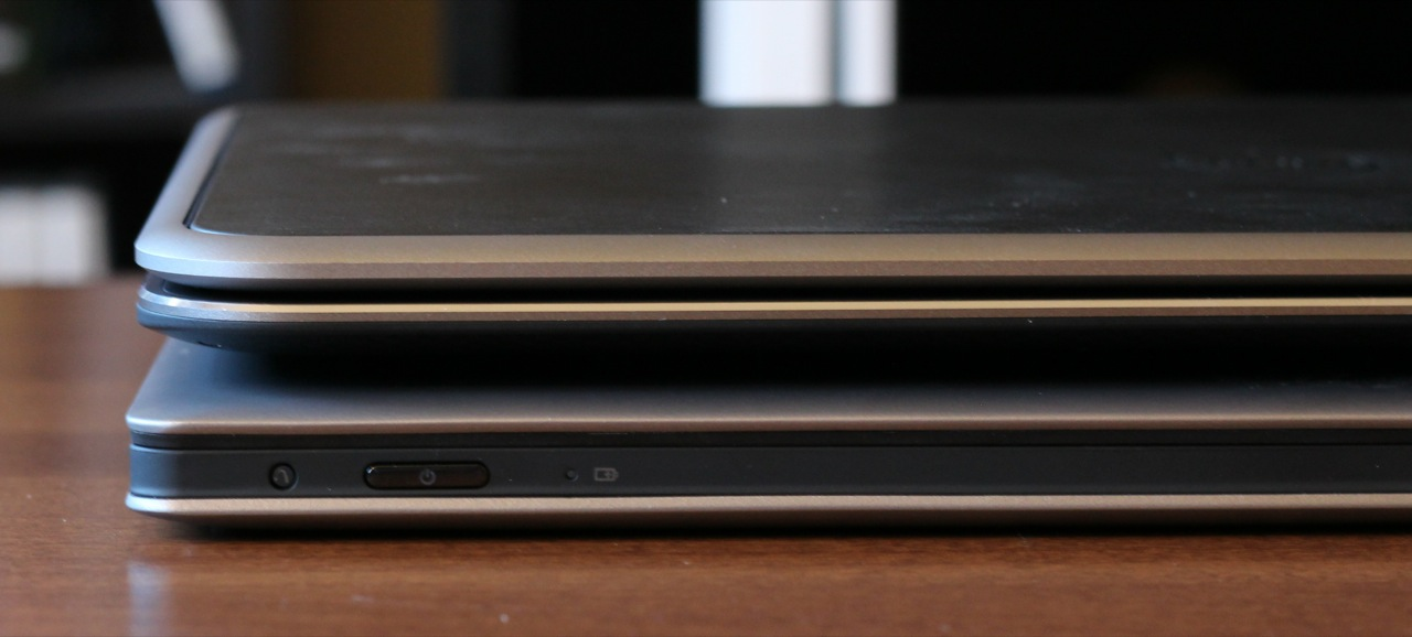 Despite its 12.5-inch screen, the XPS 12 is similar in thickness and weight to larger 13-inch Ultrabooks like the Lenovo IdeaPad Yoga (bottom).